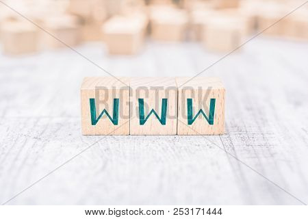 The Word Www Formed By Wooden Blocks On A White Table