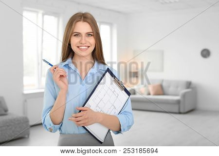 Beautiful Real Estate Agent With Clipboard Indoors