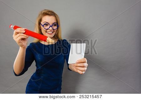 Positive Woman Blonde Student Girl Or Female Teacher, Business Coach Holding Huge Red Pencil And Not