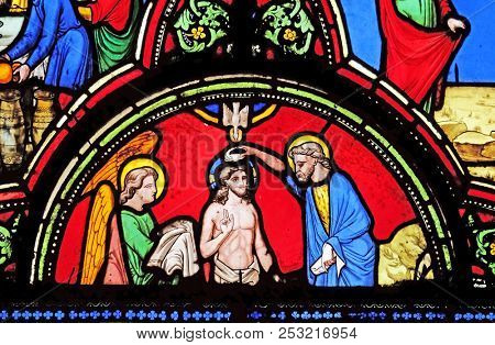 PARIS, FRANCE - JANUARY 09: Baptism of Christ, stained glass window from Saint Germain-l'Auxerrois church in Paris, France on January 09, 2018.