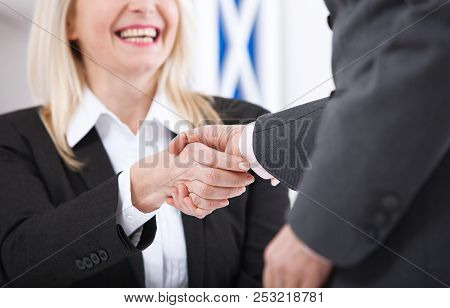 Business Handshake. Business Handshake And Business People Concept. Successful Business Woman Smilin