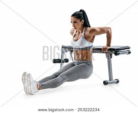 Strong Woman Working Out Arms Muscles Doing Triceps Dips Using Bench. Photo Of Latin Woman With Perf