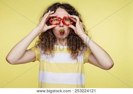 Young Pretty Lady With Gorgeous Smile And Bushy Hairstyle Having Fun Indoors Isolated Over Yellow St