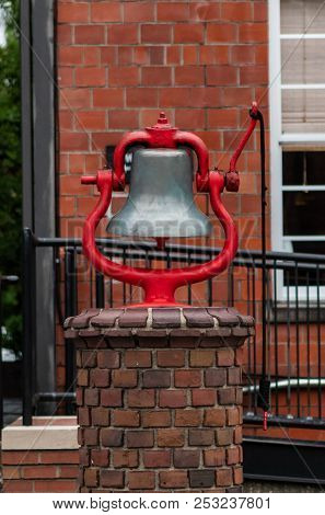 Old Bell With Red Frame In Historical Manufacturing Area