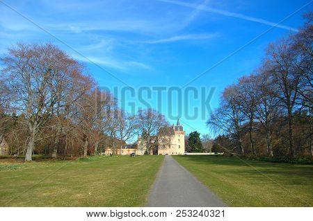 May 1st 2018 - Moray, Scotland: The Historic Brodie Castle At The End Of A Long Avenue On A Clear Sp