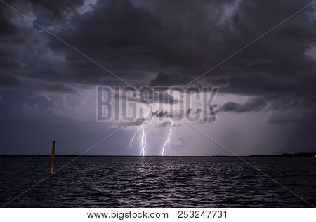 Two Bolts Of Lightning Over A Lake.