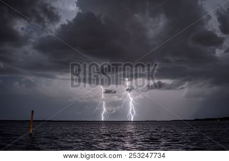 Lighting Strikes Twice In A Storm Over A Lake.
