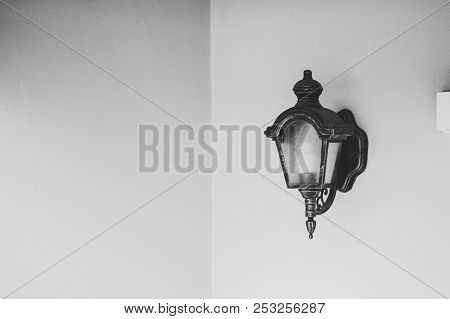 Lamp On The Wall Black And White Style.