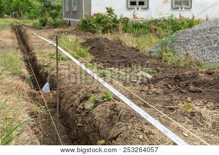 Construction Of A Fence. Layout Of The Foundation For The Fence.