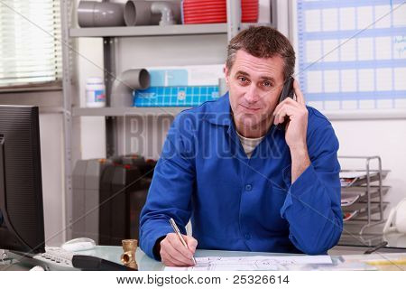 Man on the phone in a plumber's merchants poster