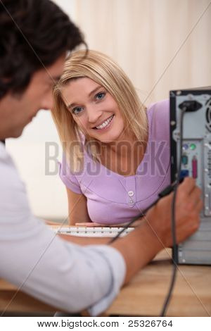 Computer technician with colleague