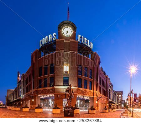 Coors Field, Home Of The Colorado Rockies Baseball Team, Showing The Glowing Lights And Vintage Bric