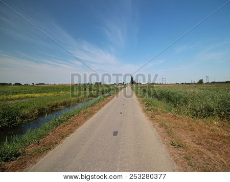 Fields And Farms With Country Road In The Zuidplaspolder In Moordrecht In The Netherlands.