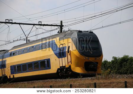 Double Decker Intercity Train On The Track At Moordrecht Heading To Gouda In The Netherlands.