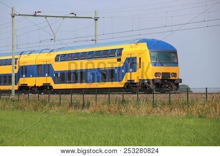 Double Decker Train On The Track At Moordrecht Heading To Gouda In The Netherlands