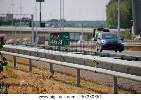 Distance Sign In Green On The Shoulder Of The Motorway A20 At Moordrecht In The Netherlands.