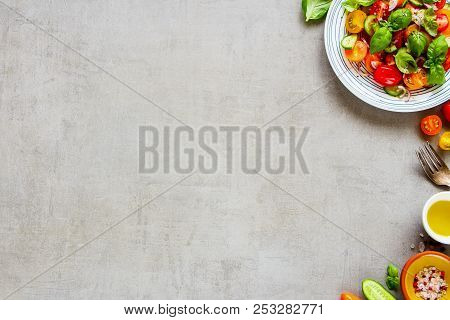 Healthy Ingredients And Colorful Salad Plate On Light Background Flat Lay. Cherry Colorful Tomatoes,
