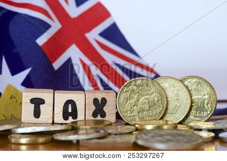 Australian Dollars With A Tax Sign And Flag.