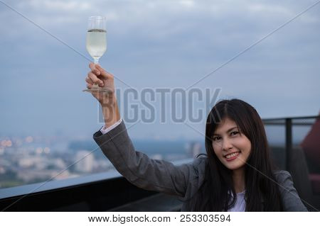 Concept Of Business Celebrations. Asian Businesswoman Is Drinking Alcohol In The Party. Young Busine