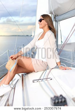 Relaxing Attractive Young Woman On Vacation Sitting On Yacht.