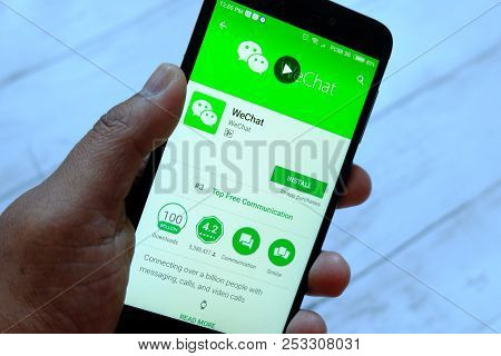 Bandar Seri Begawan,brunei - July 25th,2018 : A Male Hand Holding Smartphone With Wechat Apps On An