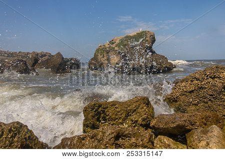 Rocky Coast On The Coast Of The Sea. Landscape