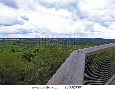 Panoramic View From A High Wooden Tower Over Woodland To The Landscape And The Cloud-sky