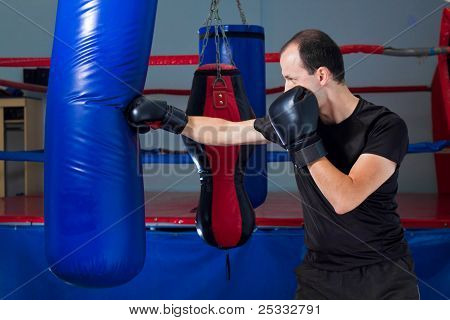 Boxer Punching A Sand Bag With Front Hand