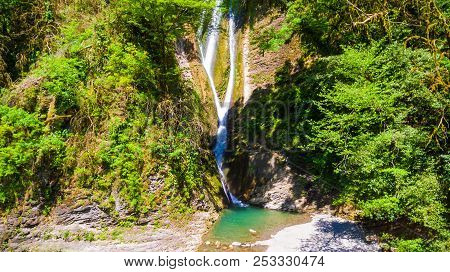 Drone View Of Orekhovsky Waterfall And Vegetation On The Steep Rock In Sunny Summer Day, Sochi, Russ