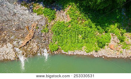Top-down Drone View Of The Sochi River And Stony Shore With Lush Vegetation In Sunny Summer Day, Rus