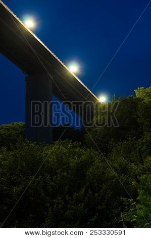 Low-angle View Of The Span And Supports Of The Zubova Schel Viaduct Over Lush Vegetation At Dusk, So