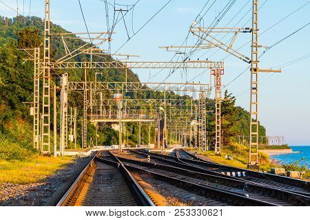 Railroad Going Into The Distance On The Background Of Mountain In Sunny Day, Sochi, Russia