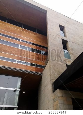 Generic Architecture Of A Building With Beautiful Brown Facade, Glass Windows And Modern Style