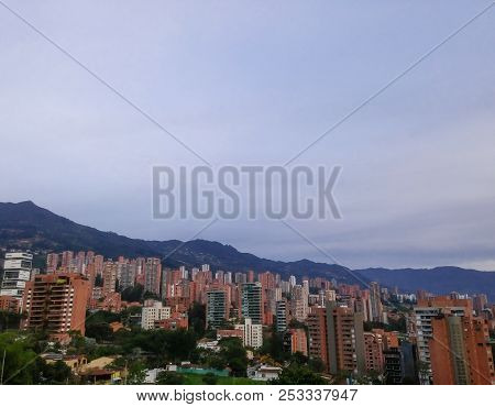 Evening View Of The Luxurious And Exclusive El Poblado Neighborhood In Medellin, Colombia, With Its