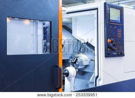 The Cnc Lathe Machine Or Turning Machine Drilling The Metal Rod With The Drill Tool And Center Drill