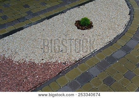 Path With Multicolored Gravel And Sidewalk From The Pavement