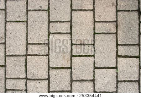 Background Of Light Gray Rectangular Sidewalk Stone With Traces Of Moss