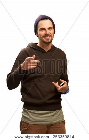 Studio Portrait Of A Good Looking Happy Young Man In Hat Against White Background With Copy Space
