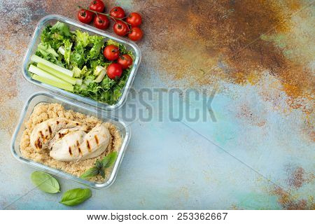 Healthy Meal Prep Containers With Quinoa, Chicken Breast And Green Salad Overhead Shot With Copy Spa