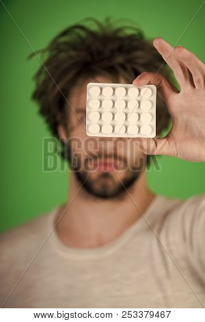 Drug and antidepressant, insomnia. Man with pills in blister pack. Cold, flu and headache treatment, hypnotic tablet. Dieting pill and vitamin, man with anabolic. Health and medicine, hangover. poster