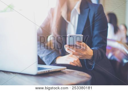 Business Woman Using Mobile Phone In Office.