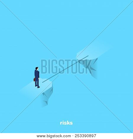 A Man In A Business Suit Stands On The Brink Of A Precipice Through Which A Thin Bridge, An Isometri