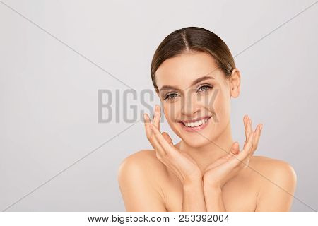 Portrait Of Beautiful Woman With Natural Make Up Touching Her Face. Beauty Young Woman With Fresh Cl