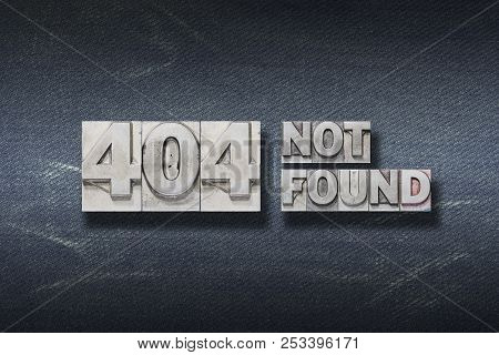 Error 404 Concept Made From Metallic Letterpress On Dark Jeans Background