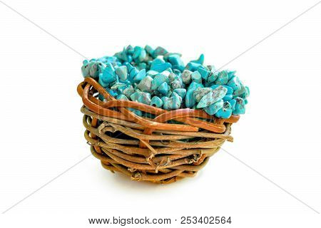 Pile Stones Of Raw Turquoise In Small Wooden Nest On A White Background. Blue And Green Color Stones