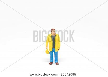 Miniature People Worker Wearing Safety Construction Concept On White Background With A Space For Tex