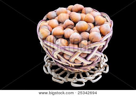 The Woven Basket  With Hazelnuts on black