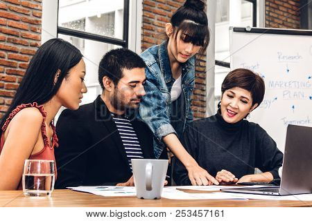 Group Of Casual Business Discussing And Working With Laptop Computer.creative Business People Planni