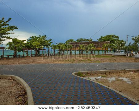 Walkway In The Park Near The Ocean Under Cloudy Sky,summer Concept