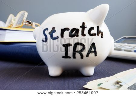 Stretch ira written on a piggy bank. Retirement. poster